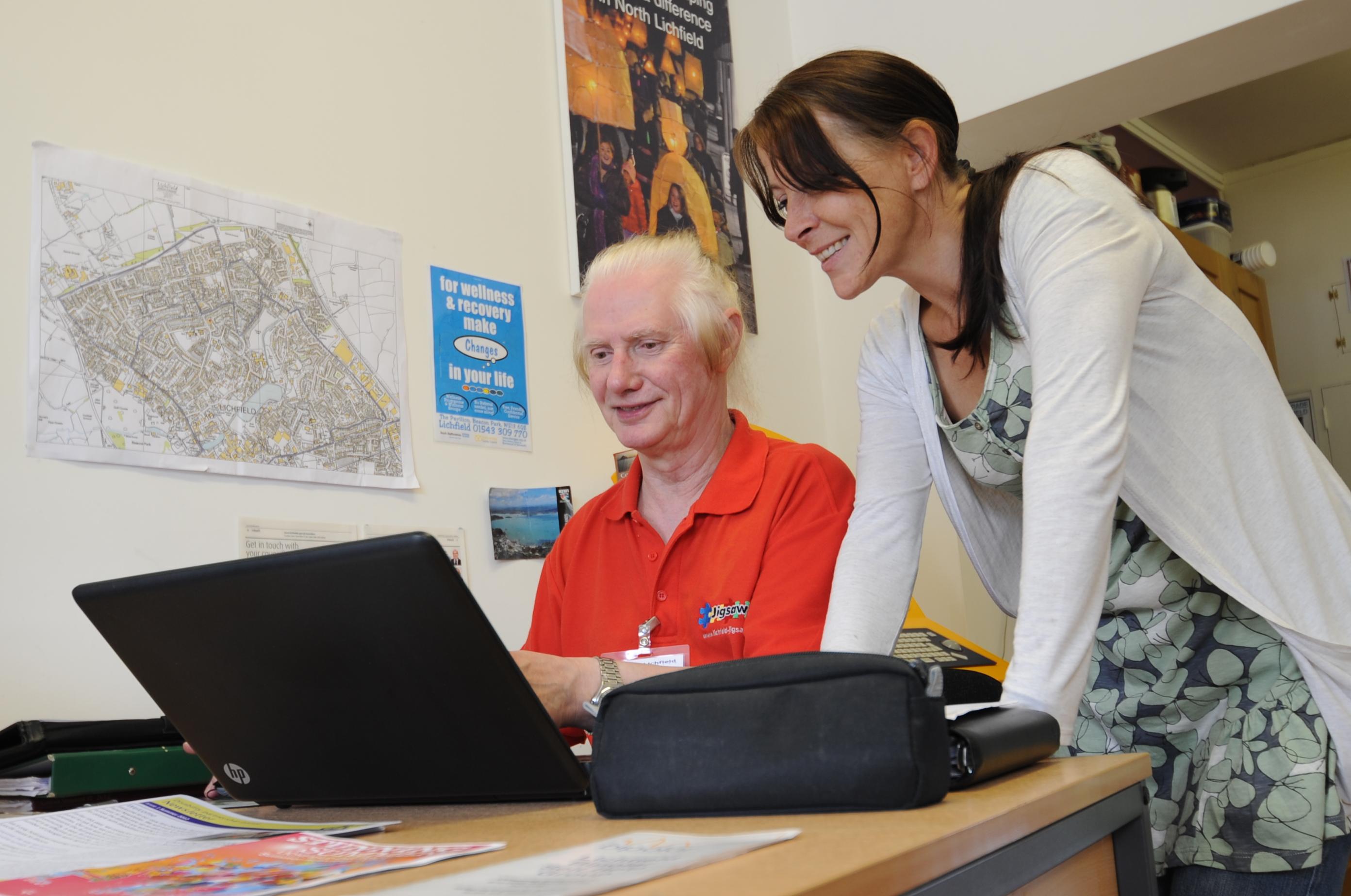 A gentleman receives computer training