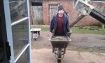 Photo of man with wheelbarrow at Project Pigsty